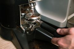 Milled coffee powder pouring holder equipment Stock Photos