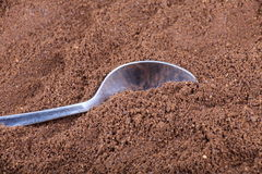 Milled coffee  and teaspoon Stock Photo