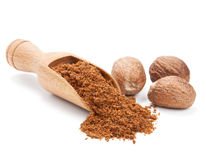 Milled nutmeg  on white Royalty Free Stock Image