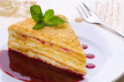 Millefeuille cake slice. With cranberry sauce in fancy background with fork. This cake is also called Napoleon stock photos