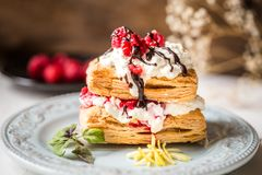 Millefeuille dessert with fresh raspberry and chocolate. Mint Royalty Free Stock Photography