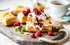 Millefeuille dessert with fresh raspberry and chocolate. Mint Stock Images