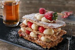 Millefeuille dessert with strawberries dessert sweet on black background cake royalty free stock images