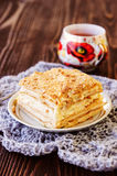 Millefeuille pastry with a cup of tea on wooden table Stock Photos
