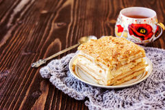Millefeuille pastry in a plate on wooden table Royalty Free Stock Photo