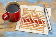 Millenials word cloud on napkin. Millenials word cloud on a napkin a cup of coffee - demography concept Royalty Free Stock Images