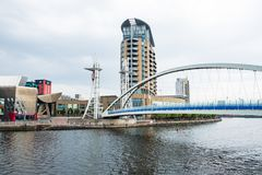 Millenium bridge at the Salford Quays on the banks of the Manchester Ship Canal in Salford and Trafford, Greater Manchester. Manchester, United Kingdom - April stock images