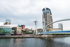 Millenium bridge at the Salford Quays on the banks of the Manchester Ship Canal in Salford and Trafford, Greater Manchester. Manchester, United Kingdom - April stock photography
