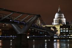 Millenium Bridge and St. Paul`s Cathedral, London. From the south bank of the Thames River, the pedestrian only Millenium Bridge crosses the river, and leads to Royalty Free Stock Images