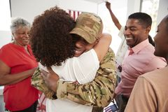 Millennial African American  soldier returning home embracing family members,close up royalty free stock image
