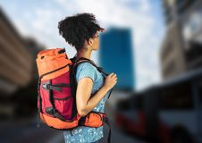 Millennial backpacker searching on blurry street Royalty Free Stock Photos