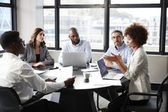 Free Millennial Black Businesswoman Addressing Colleagues At A Corporate Business Meeting, Close Up Stock Photos - 153629913