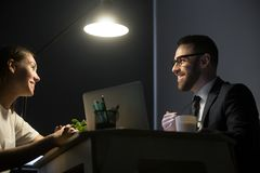 Happy colleagues discussing successful business plan in office a Stock Images