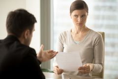 Manager trying to convince doubtful female client Royalty Free Stock Images