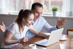 Millennial couple excited winning lottery on line royalty free stock images