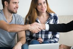 Millennial couple handshake consultant overcoming therapy sessio royalty free stock photo