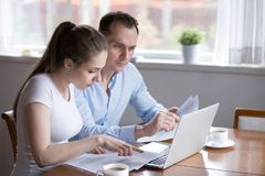 Millennial couple studying contract for new house before signing royalty free stock photos