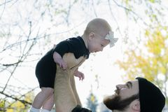 Millennial Dad Holding Baby Daughter Up Showing Affection Stock Photography