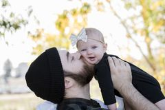 Millennial Dad Holding Baby Daughter Up Showing Affection Royalty Free Stock Photos