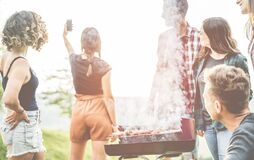 Millennial friends taking selfie on barbecue fire at backyard outdoor dinner party - Young people - Summer lifestyle and cooking