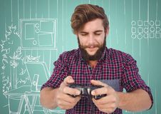 Millennial man playing video games against aqua and white hand drawn office Royalty Free Stock Photo