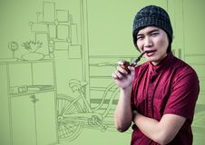 Millennial man smoking pipe against green hand drawn office. Digital composite of Millennial man smoking pipe against green hand drawn office Royalty Free Stock Photo