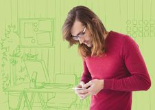 Millennial man texting against green hand drawn office Stock Photography