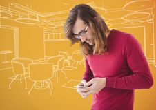 Millennial man texting against orange and white hand drawn office Stock Photography