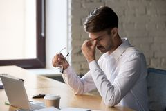 Free Millennial Office Worker Taking Off Eyeglasses Suffers From Eyes Strain Stock Image - 147367391