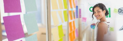 Millennial woman against charts and sticky note transition. Digital composite of Millennial woman against charts and sticky note transition royalty free stock images