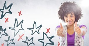 Millennial woman giving two thumbs up against white wall with red and blue hand drawn star pattern a Royalty Free Stock Photo