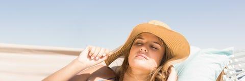 Millennial woman with sun hat asleep on hamoc against Summer sky stock illustration