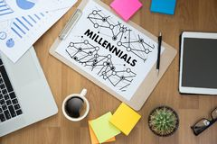 MILLENNIALS CONCEPT Business team hands at work with financial r stock photo