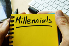 Millennials. Millennials handwritten in a note Royalty Free Stock Photo