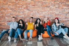 Millennials protesting ambitious generation. Millennial business team voting against idleness. Ambitious, hardworking generation. Young people showing thumbs stock photography