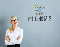 Millennials text with business woman. On a gray background Royalty Free Stock Photography