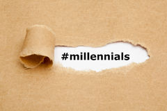 Millennials Torn Paper Concept. Hashtag Millennials appearing behind torn brown paper. Millennials, also known as Generation Y, are the demographic cohort royalty free stock photo