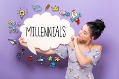 Millennials with woman holding a speech bubble. Millennials with young woman holding a speech bubble stock photo