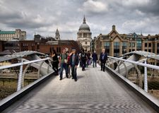 Millennium Bridge. Background is St Paul's cathedral in London Stock Photography