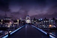 Millennium Bridge in London at night. Iconic view of the Millennium Bridge in London royalty free stock photography