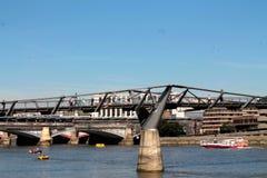 Millennium Bridge, London. A steel pedestrian bridge over the Thames river in London, England Royalty Free Stock Images