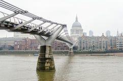 The Millennium Bridge, London, UK. The Millennium Bridge against St Paul Cathedral, London, UK stock photo