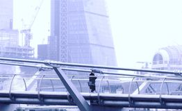 Free Millennium Bridge, London UK. Jan 20 2018. A Lady With Umbrella Texting As She Walks Alone Along The Millennium Bridge In The Rain Royalty Free Stock Images - 108316379