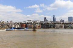 Millennium Bridge and modern glazed office buildings, London, United Kingdom. LONDON, UNITED KINGDOM - JUNE 22, 2017: Millennium Bridge and modern glazed office Royalty Free Stock Photography