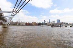 Millennium Bridge and modern glazed office buildings,London, United Kingdom. LONDON, UNITED KINGDOM - JUNE 22, 2017: Millennium Bridge and modern glazed office Stock Photography