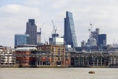 Millennium Bridge and modern glezed office buildings, London, United Kingdom. LONDON, UNITED KINGDOM - JUNE 22, 2017: Millennium Bridge and modern glezed office Royalty Free Stock Photography