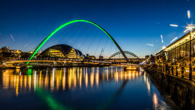 Millennium bridge - Newcastle quayside. Newcastle's quayside and bridges just after sundown showing the colourful lighting Royalty Free Stock Images
