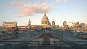 The Millennium Bridge and Saint Paul Cathedral in London. London, United Kingdom - December 8 2015: People walking at the  Millennium bridge , officially known Royalty Free Stock Photos