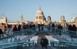 The Millennium Bridge and Saint Paul Cathedral in London. London, United Kingdom - December 8 2015: People walking at the  Millennium bridge , officially known Stock Photo