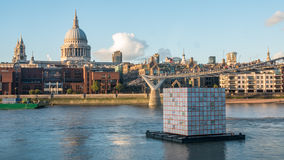 The Millennium bridge with St Paul cathedral and the skyline of the City of London at sunset Stock Photo